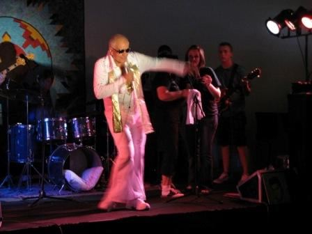Elvis Impersonator on Stage