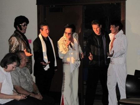 Elvis Impersonator Singing with Group