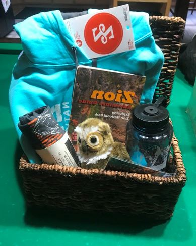 Gift Basket: Hoodie, walking stick, water bottle, plush, stickers, and a Tshirt.  Value $120.  Silent auction.