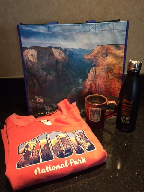Recycled Zion tote bag package containing tote bag, Zion Narrows Mug from Deneen Pottery, Zion water bottle and Zion sweatshirt.  Value $60.  Silent Auction, minimum bid TBD.